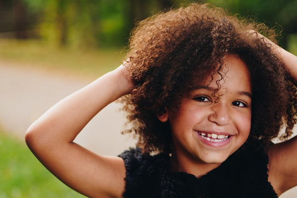 Little girl with kinky hair