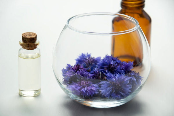 Flower essential oils in different containers