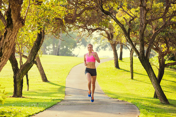 Woman jogging on pathway