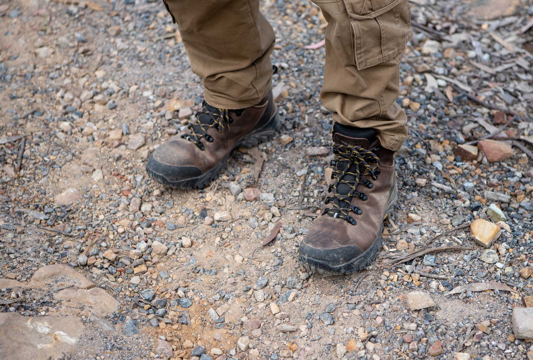 Man wearing hiking boots with solid toe boxes