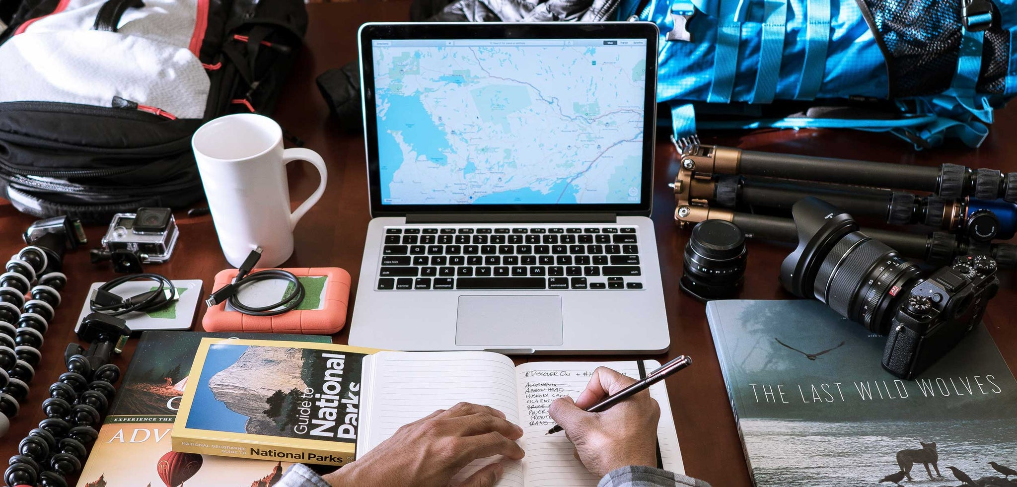 Preparing for travel - man behind a laptop and a map