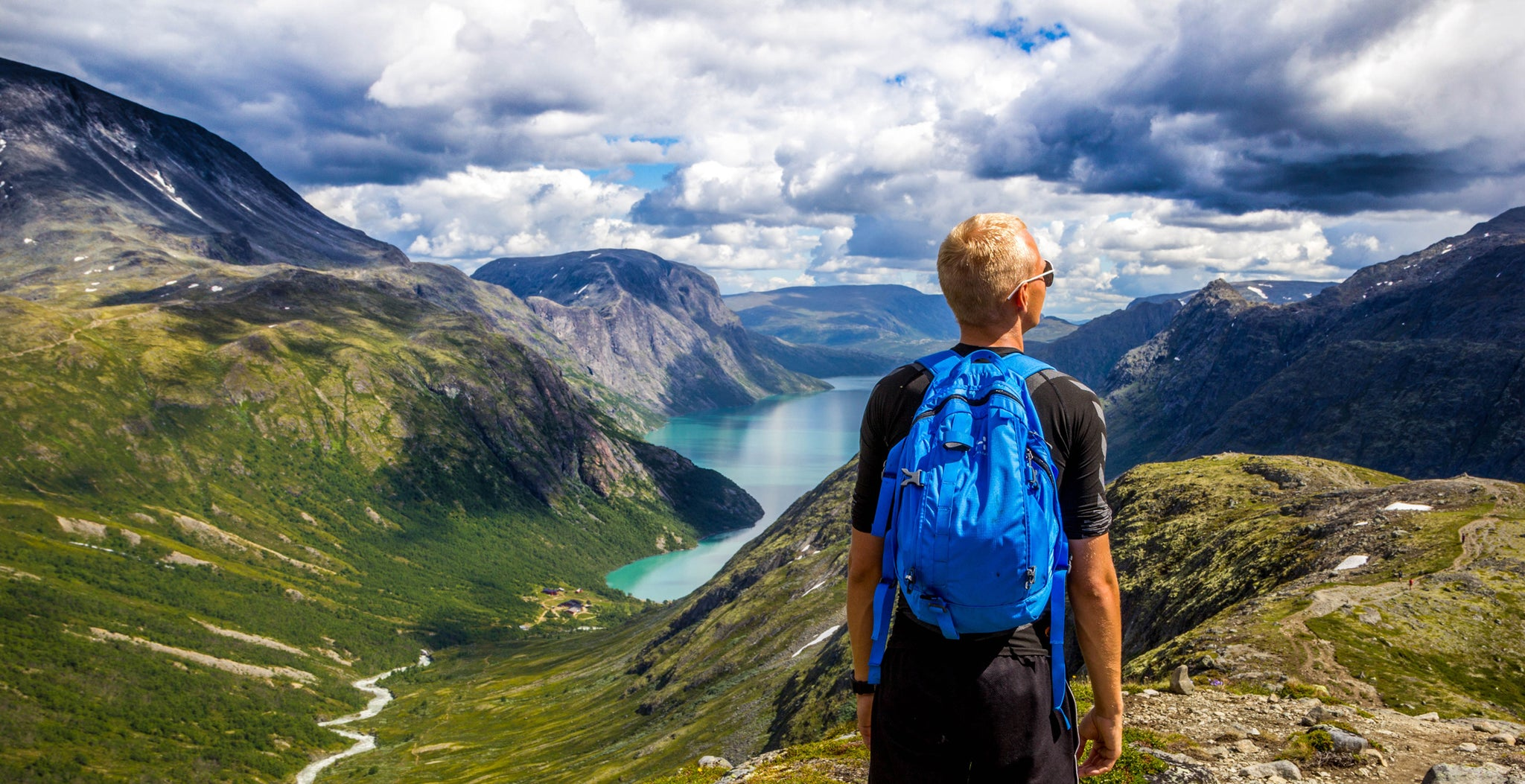 How to choose the best hiking backpack: hiker wearing blue day pack
