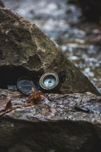 Compass on a rock