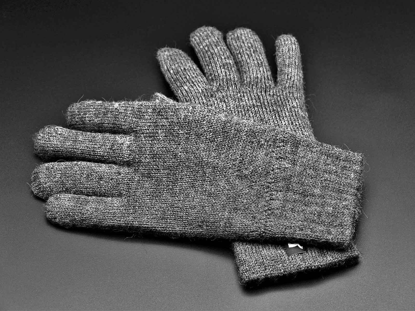 A pair of wool liner gloves