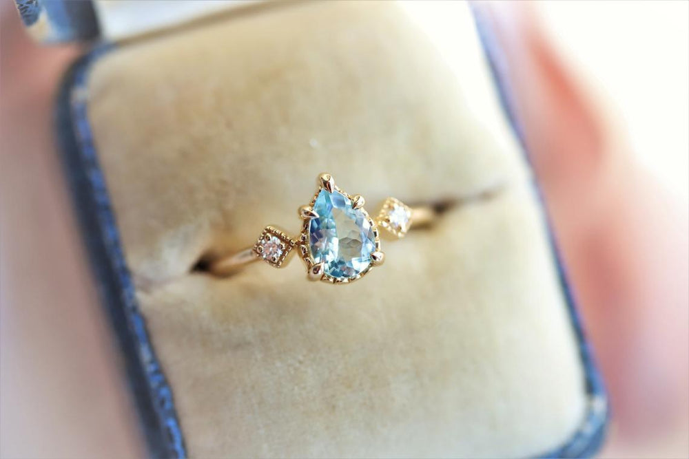 Carrie |  14K Pear Aquamarine & Diamond Side Stone Milgrain Ring