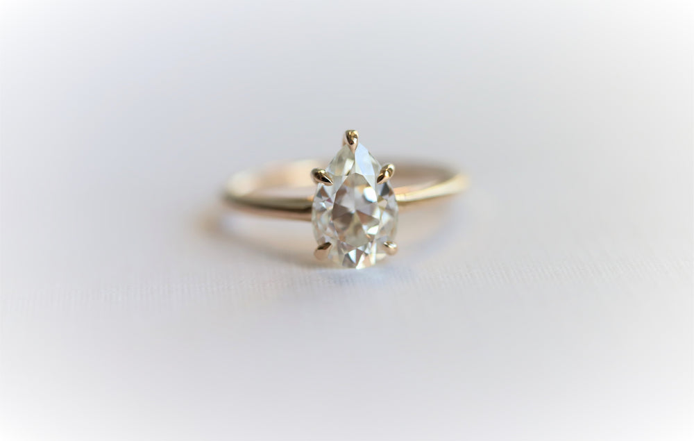 AVA | Pear 9 x 6 ct DEF Charles & Colvard Moissanite® Cathedral Style Solitaire Ring