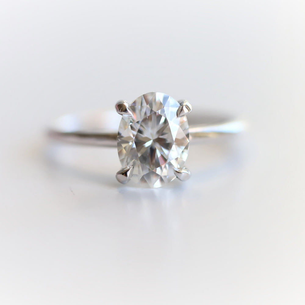 AVA | 8 x 6 mm Oval DEF Charles & Colvard Moissanite® Dainty Cathedral Solitaire Ring
