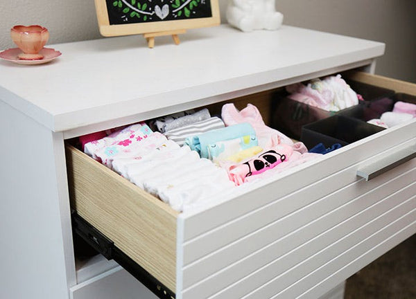 Organise baby clothes with drawer dividers