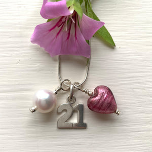 Three charm necklace in Sterling Silver with rose pink (cerise) glass heart, '21' and pearl