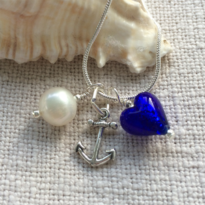 Three charm necklace w/ dark blue Murano glass heart, silver anchor & white pearl on silver chain