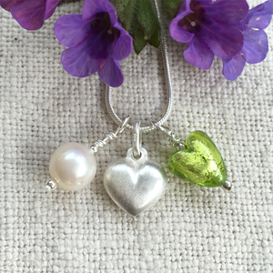 Three charm necklace in silver with light green (peridot) heart and *20 charm options*