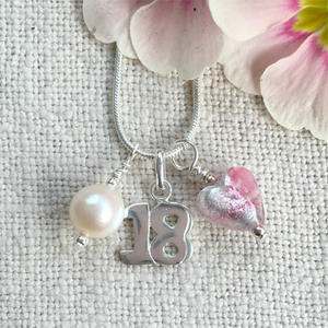 Three charm necklace in Sterling Silver with candy stripe pink glass heart, '18' and pearl