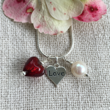 Three charm necklace in silver with red heart and *20 charm options*