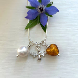 Three charm necklace in silver with brown topaz (amber) heart and *20 charm options*