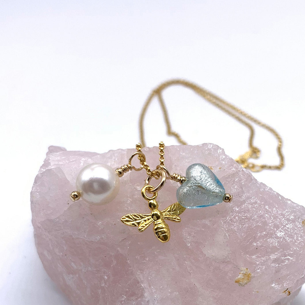 Charm necklace with aquamarine Murano glass heart, honey bee & pearl on gold chain