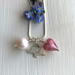 Charm necklace with rose pink (cerise) Murano glass heart, elephant & pearl on silver chain