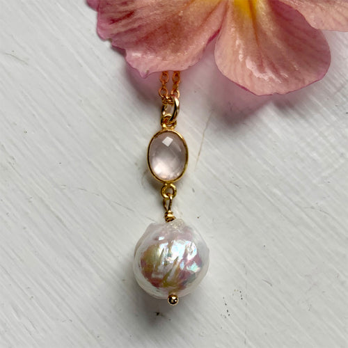 Gemstone necklace with rose quartz (pink) crystal and large pearl pendant on gold chain