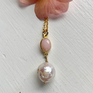 Gemstone necklace with pink opal crystal and large pearl pendant on gold cable chain