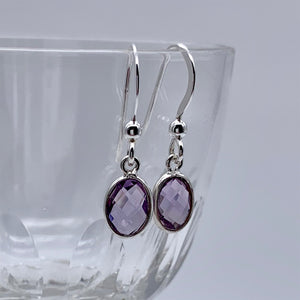 Gemstone earrings with amethyst (purple) crystal drops on silver hooks