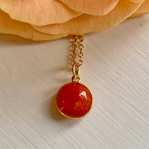 Gemstone necklace with carnelian (red) crystal pendant on gold cable chain