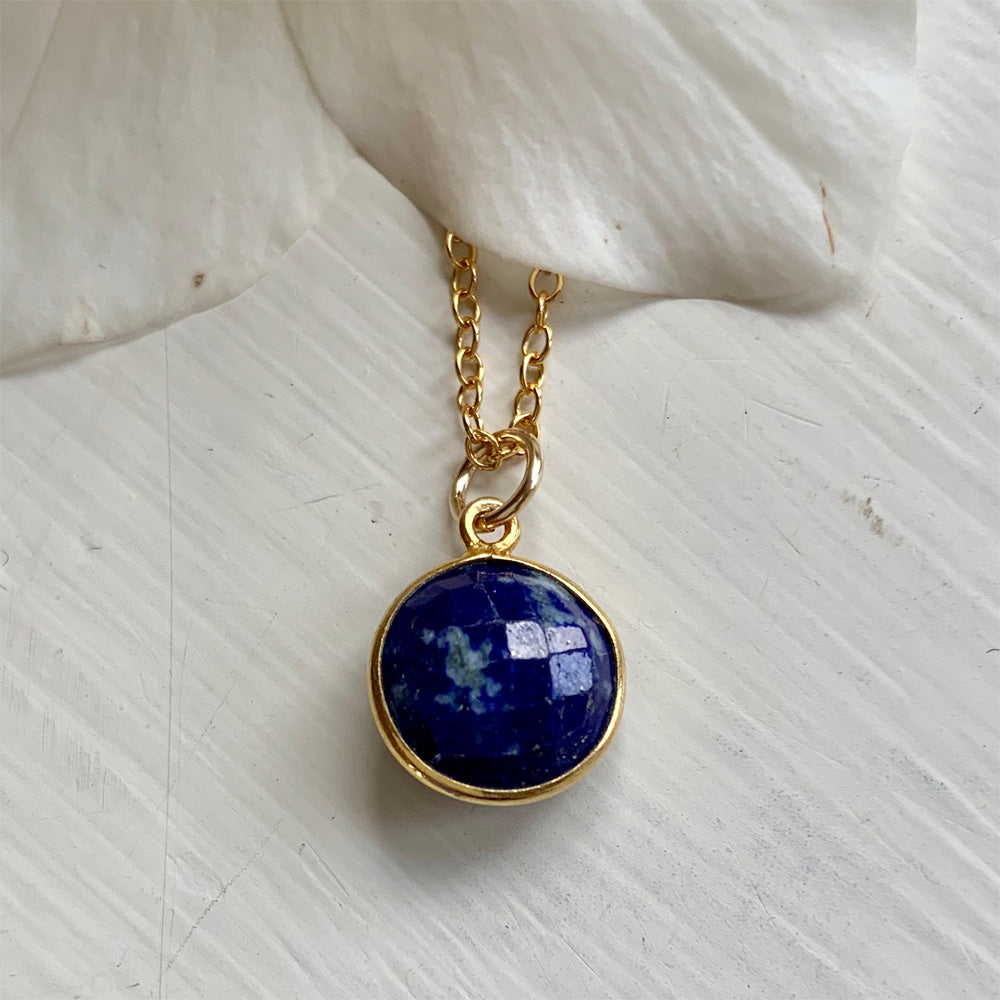 Gemstone necklace with lapis lazuli (blue) crystal pendant on gold cable chain
