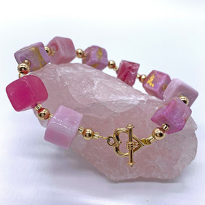 Bracelet with shades of pink and gold Murano glass cube beads on 22 Carat gold vermeil