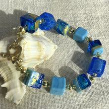 Bracelet with shades of blue and gold Murano glass cube beads on 22 Carat gold vermeil