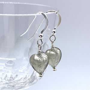 Earrings with grey (it. grigio) Murano glass mini heart drops on silver or gold hooks