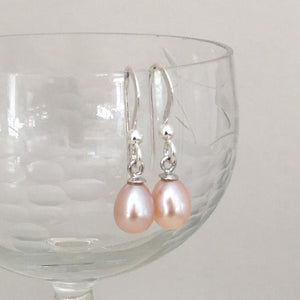 Pearl earrings with small freshwater natural pink oval pearl drops on silver hooks