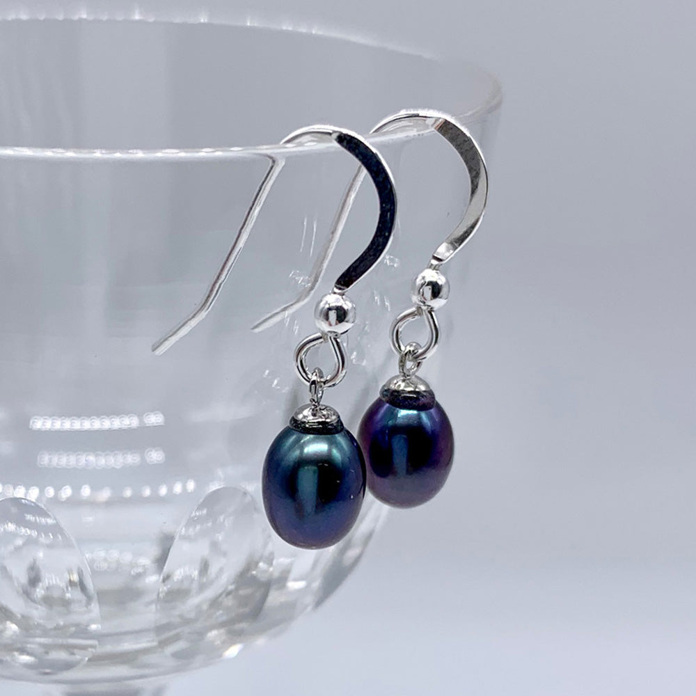 Pearl earrings with small freshwater natural black oval pearl drops on silver hooks