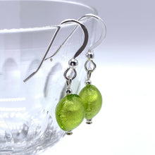 Earrings with light green (peridot) Murano glass mini lentil drops on silver or gold hooks