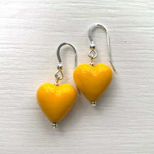 Earrings with yellow pastel Murano glass small heart drops on silver or gold hooks