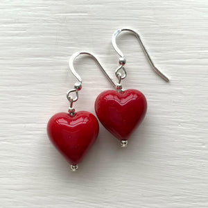 Earrings with red pastel Murano glass small heart drops on silver or gold hooks