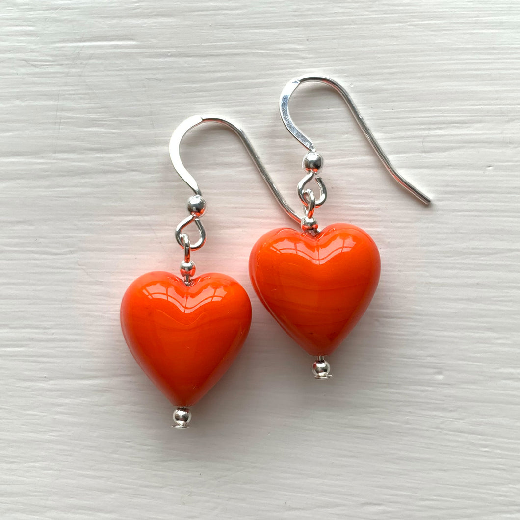 Earrings with orange pastel Murano glass small heart drops on silver or gold hooks