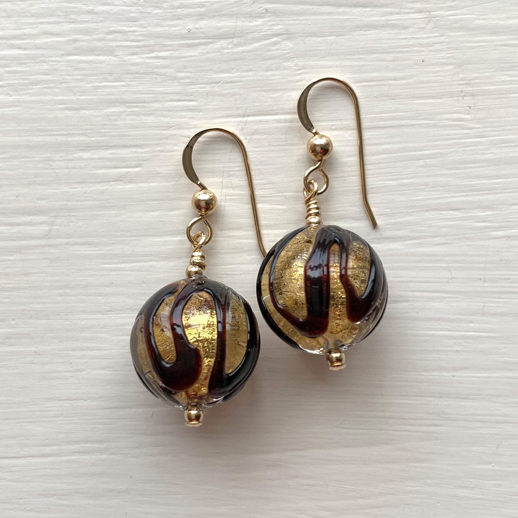 Earrings with black appliqué over gold Murano glass sphere drops on silver or gold hooks