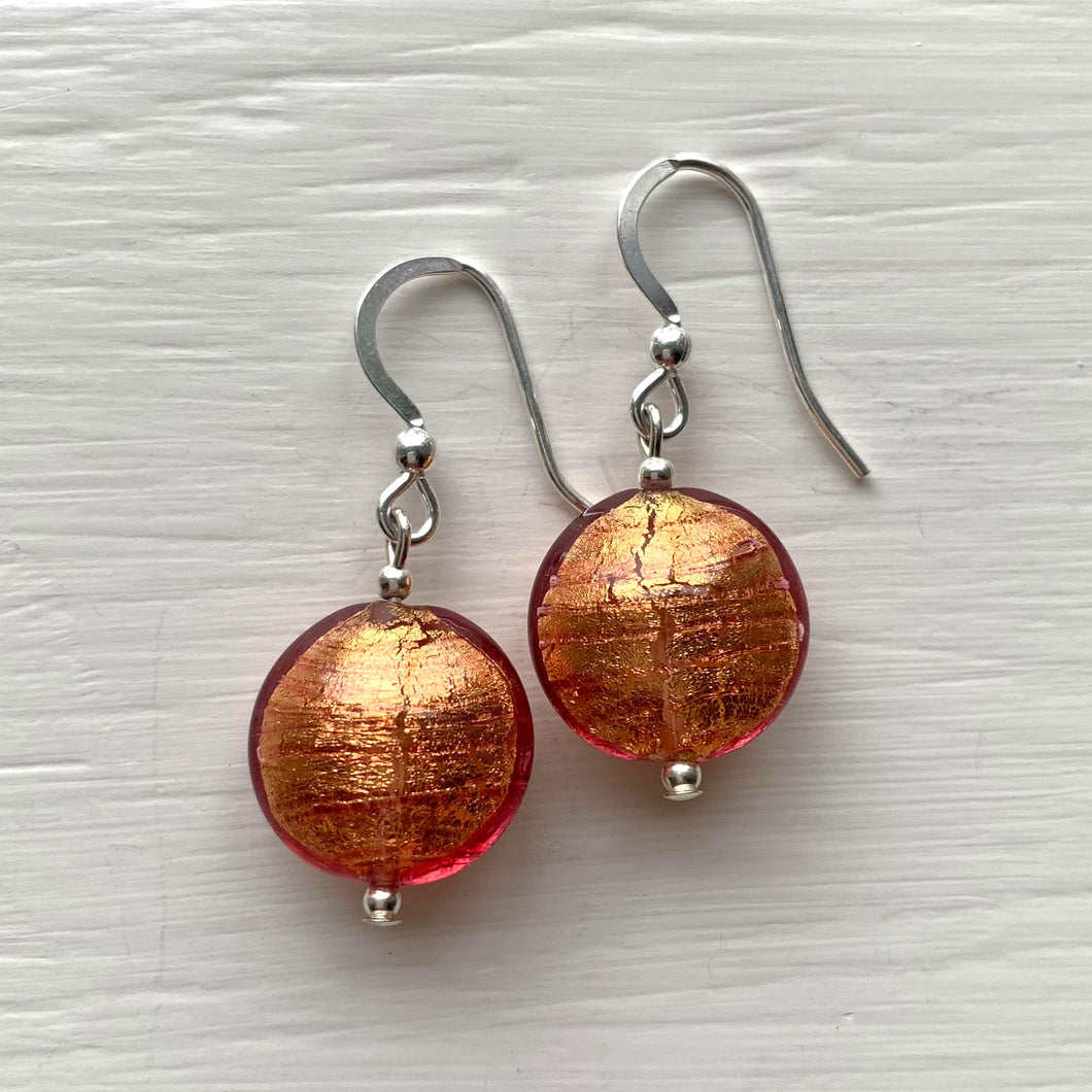Earrings with burnt orange Murano glass small lentil drops on silver or gold hooks