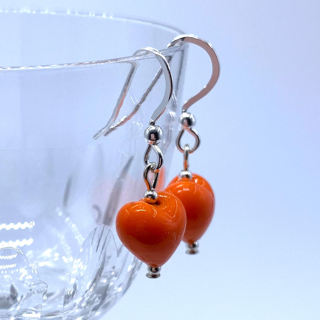 Earrings with orange pastel Murano glass mini heart drops on silver or gold hooks