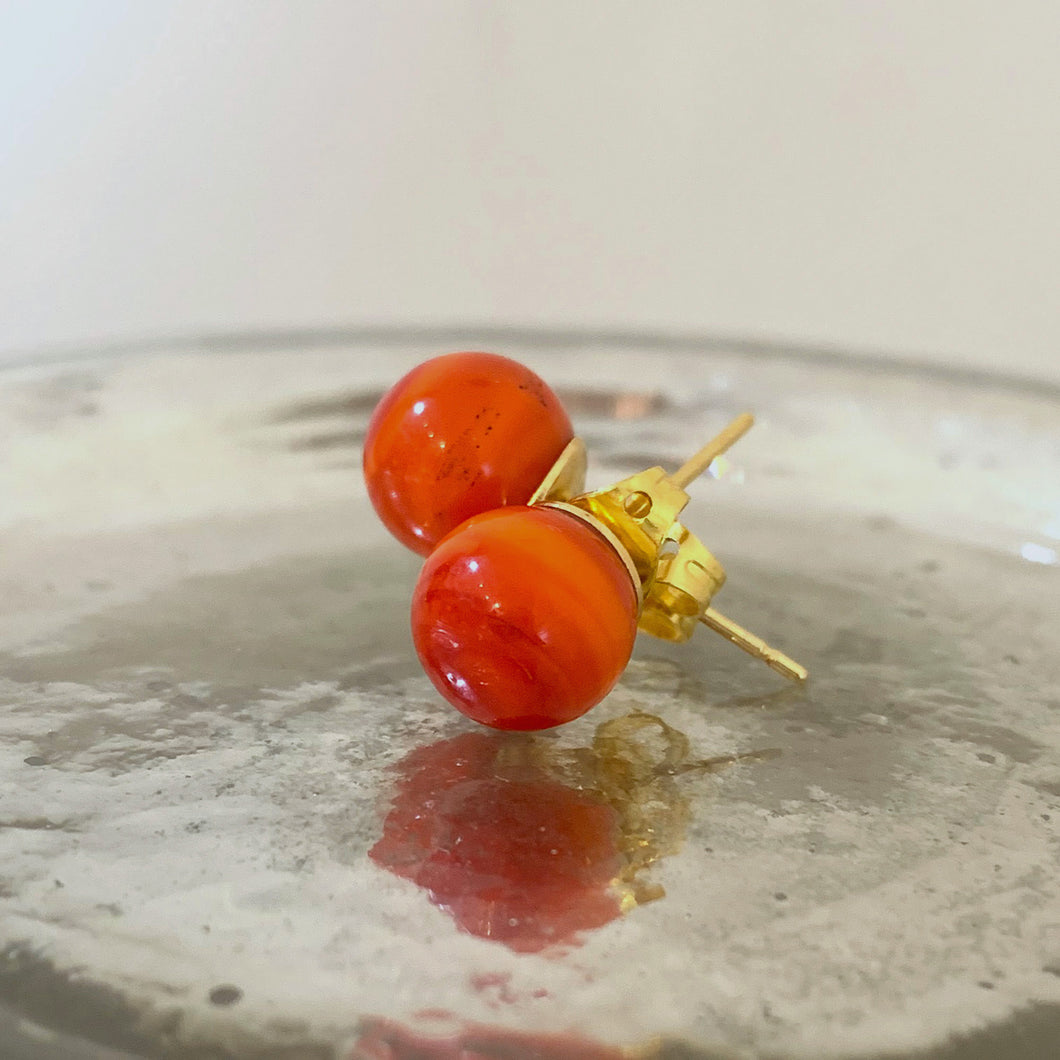 Earrings with light red pastel Murano glass sphere (round) studs on gold posts
