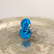 Earrings with blue translucent and white flake Murano glass sphere studs on surgical steel