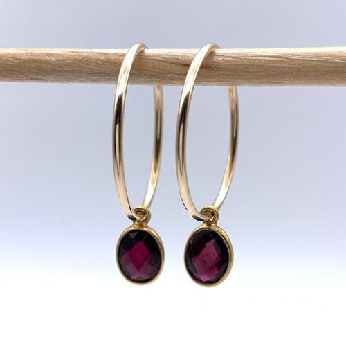 Gemstone earrings with garnet (dark red) oval crystal drops on gold large hoops