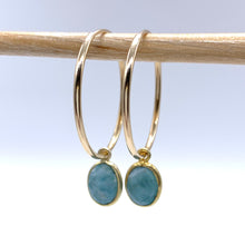 Gemstone earrings with larimar (aqua, blue) oval crystal drops on gold large hoop ear wires