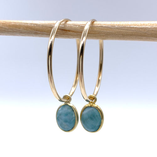 Gemstone earrings with larimar (aqua, blue) oval crystal drops on gold large hoops