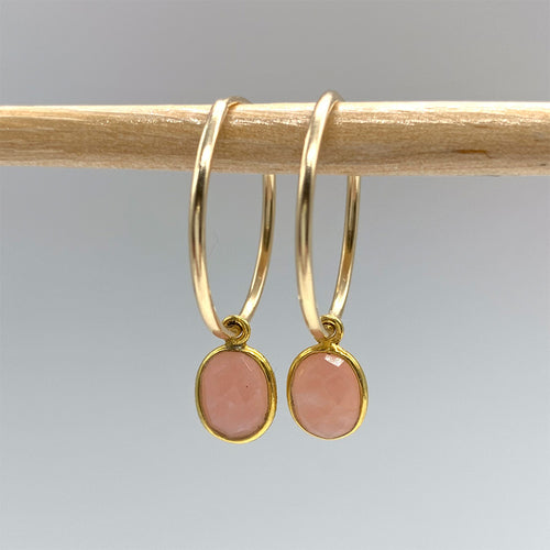 Gemstone earrings with pink opal oval crystal drops on gold medium hoop ear wires