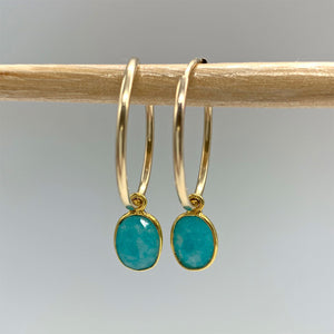 Gemstone earrings with amazonite (blue) oval crystal drops on gold medium hoops