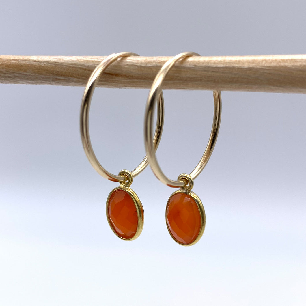 Gemstone earrings with carnelian (red) oval crystal drops on gold medium hoops