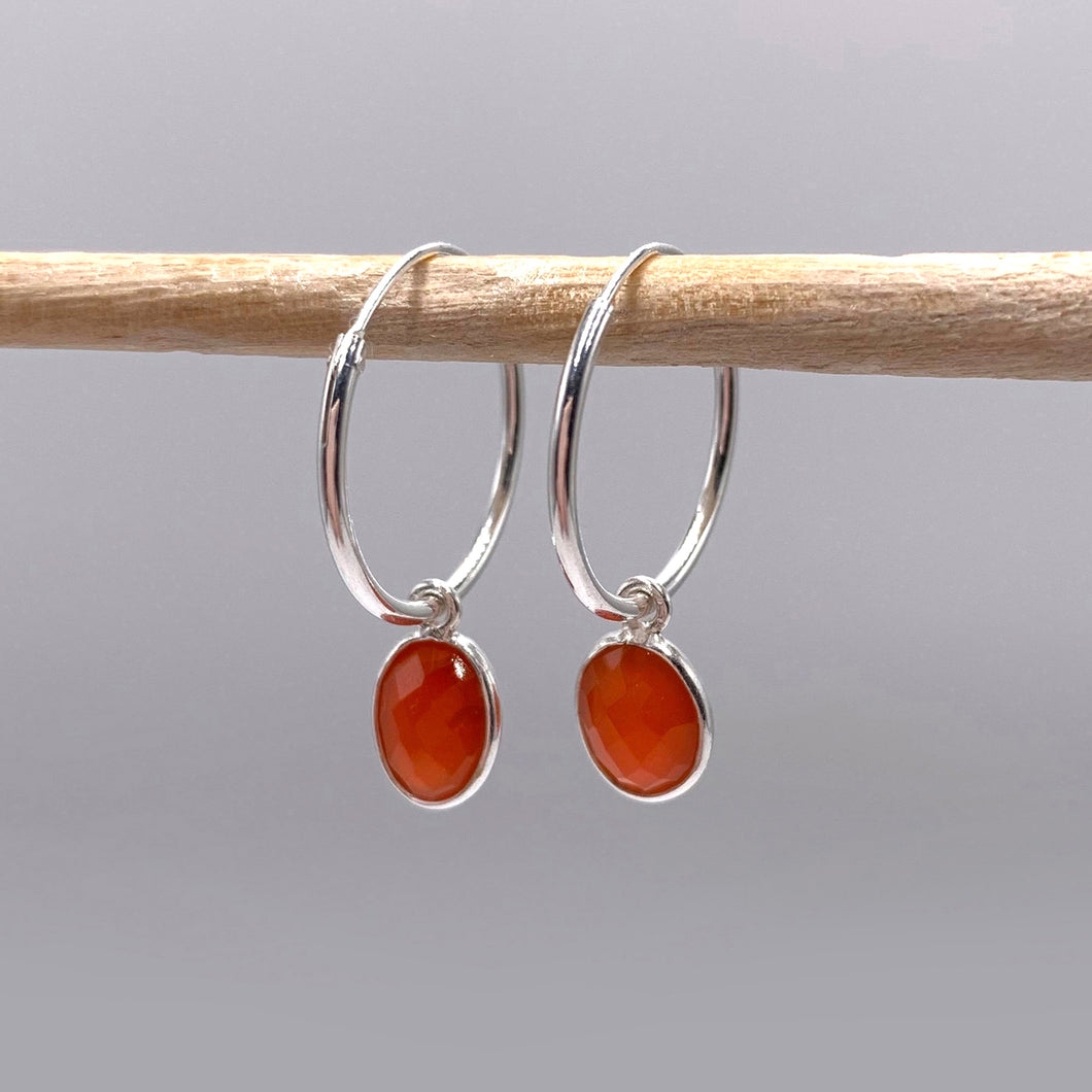 Gemstone earrings with carnelian (red) oval crystal drops on silver small hinged hoops