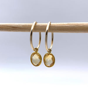 Gemstone earrings with citrine (yellow) oval crystal drops on gold small hoops