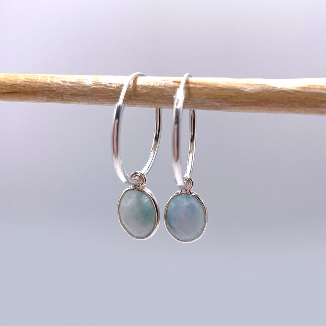 Gemstone earrings with larimar (aqua, blue) oval crystal drops on silver small hinged hoops