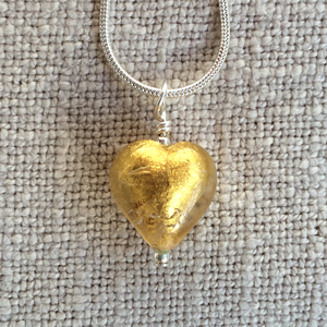 Necklace with light (pale) gold Murano glass small heart pendant on silver snake chain