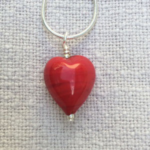 Necklace with red pastel Murano glass small heart pendant on silver snake chain